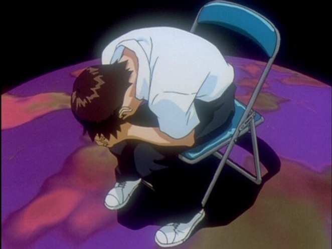 Shinki Ikari is leaning his head into his hands when dealing with an existential threat in the final episode of Neon Genesis Evangelion.