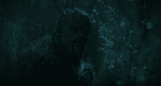 Swamp Thing (Derek Mears) stares after Abby, shrouded in darkness.
