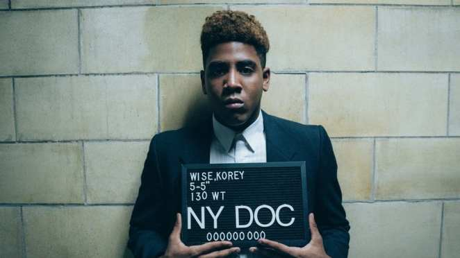Korey Wise (Jharrel Jerome) poses for his mug shot in Netflix's When They See Us