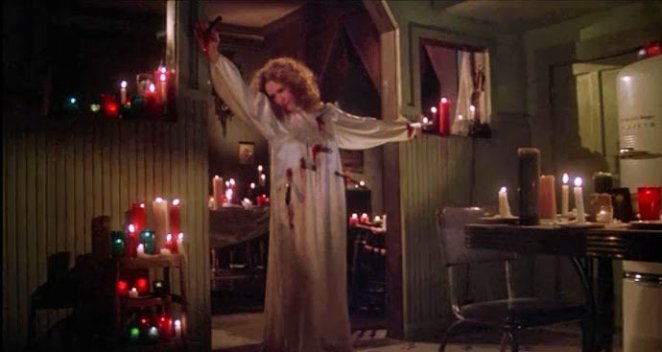 Margaret White (Piper Laurie) gets the best death in Brian DePalma's Carrie (1976).