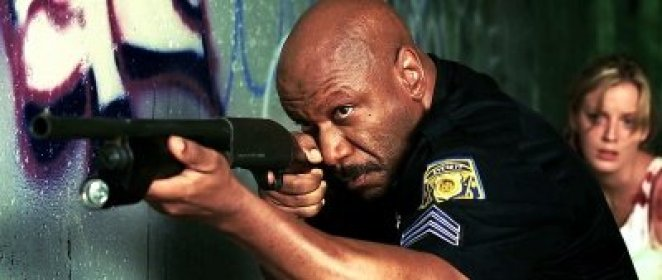 Actor Ving Rhames raises a gun in Dawn of the Dead remake.