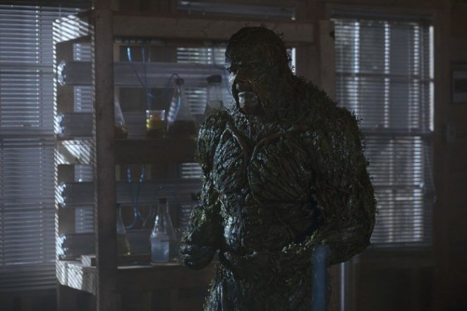 Swamp Thing (Derek Mears) pondering his existence in the lab that was his as Alec Holland (Andy Bean).