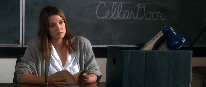 Karen Pomeroy, an English Teacher sitting in front of a black board that has Cellar Door written in chalk