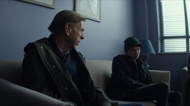 Ed talks to his son Sam on the sofa