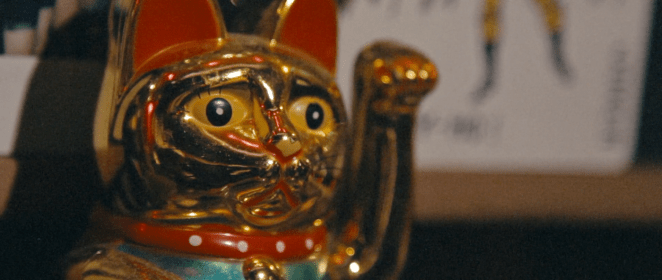 A chinese lucky waving cat made of gold