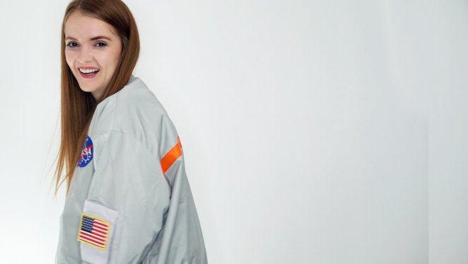 Horror YouTuber Spookyastronauts poses in here NASA jacket