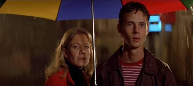 Manuela and Esteban waiting in the rain