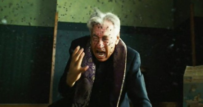 Priest Father Callaway is attacked by bees while attempting to bless a house in The Amityville Horror (2005).