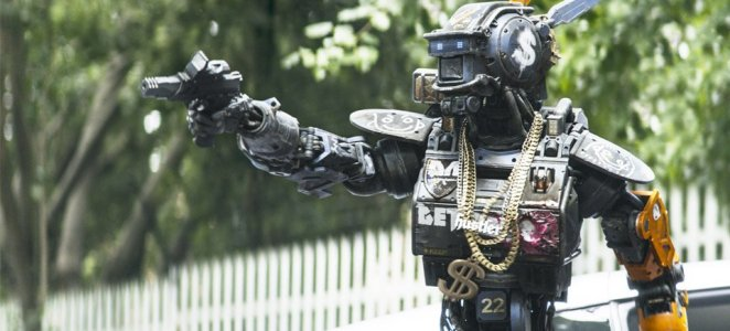 Chappie holds his gun like a gangster as he threatens the bad guys he believes stole his fathers car