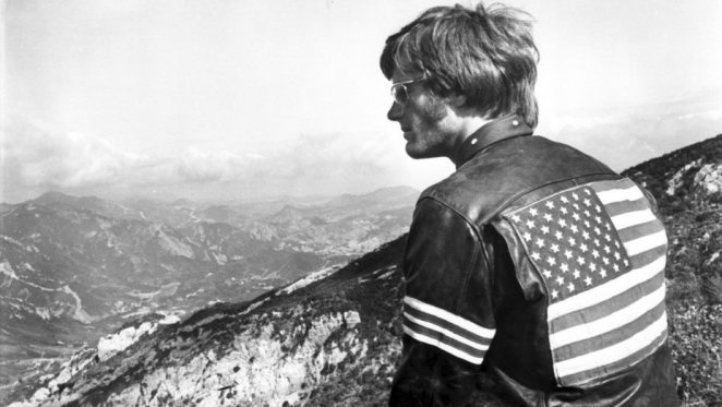 Peter Fonda looks out over mountains