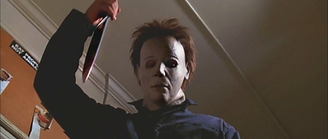 Michael Myers raises his knife before plunging it into his victim