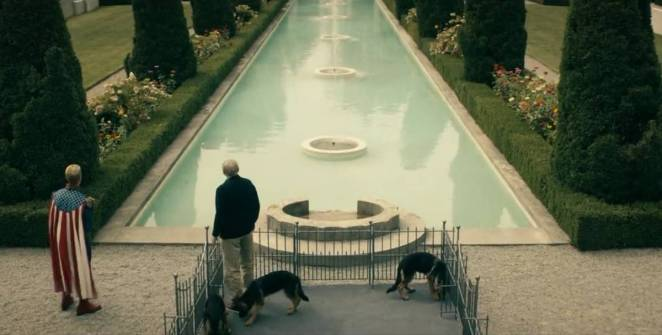 Homelander and Dr. Vogelbaum look out over his well manicured estate gardens.
