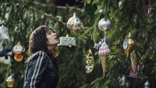 Vic looks at a tree with ornaments on it