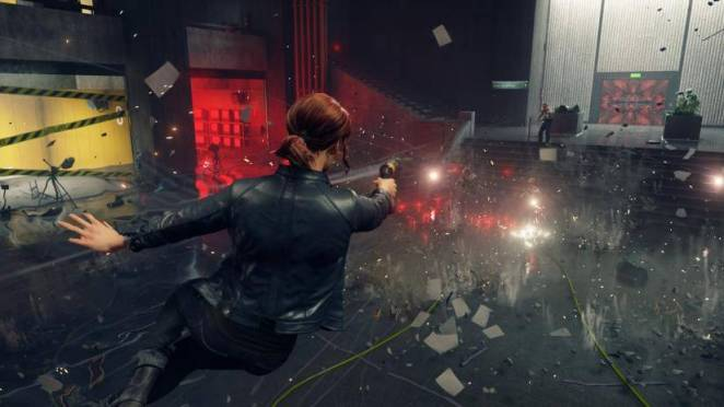 Jesse jumps to the right while firing a gun in Control