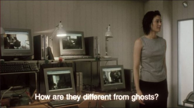 A Japanese woman stands in front of computers in Pulse
