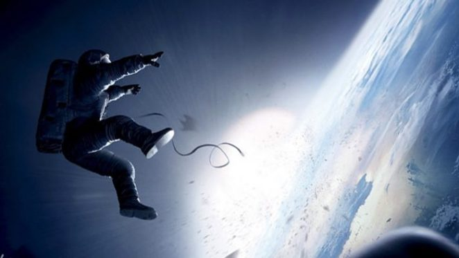 An astronaut floats away from the spaceship