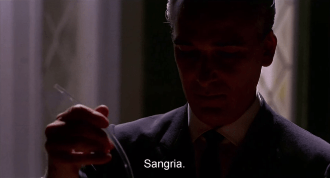 Jose, cloaked in shadows, offers sangria to Giulietta