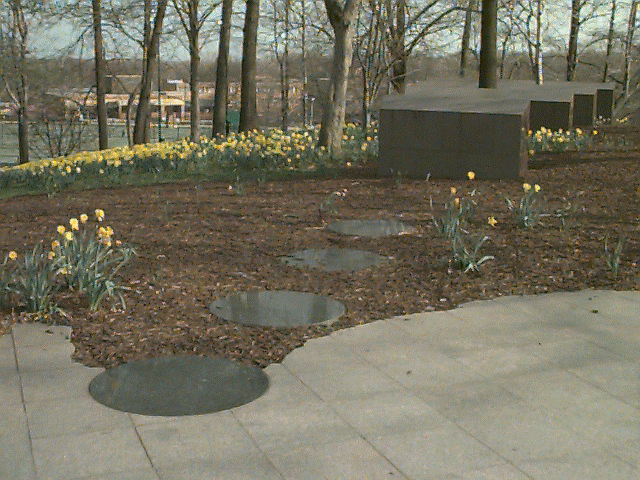 The May 4th Memorial at Kent State consists on smooth stone on the ground leading up to several virtually rectangular stone pillars