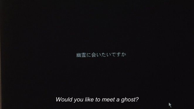 White Japanese characters appear on a black background with the question Would you like to meet a ghost? in Pulse