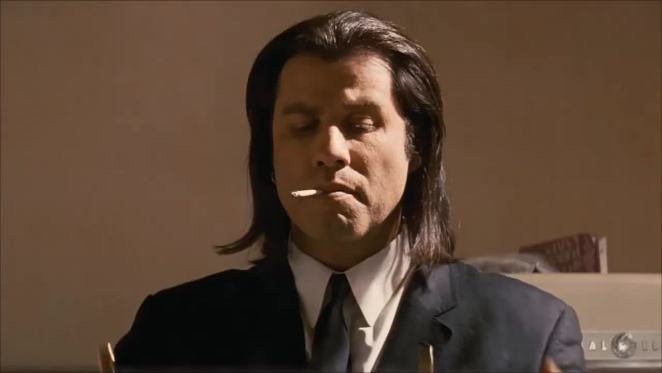 Vincent Vega (John Travolta) smokes a cigarette