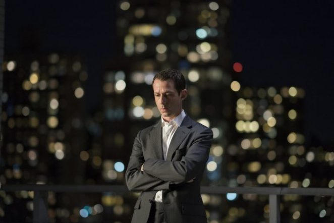 Kendall Roy (Jeremy Strong) contemplates his failures in front of the NYC night sky
