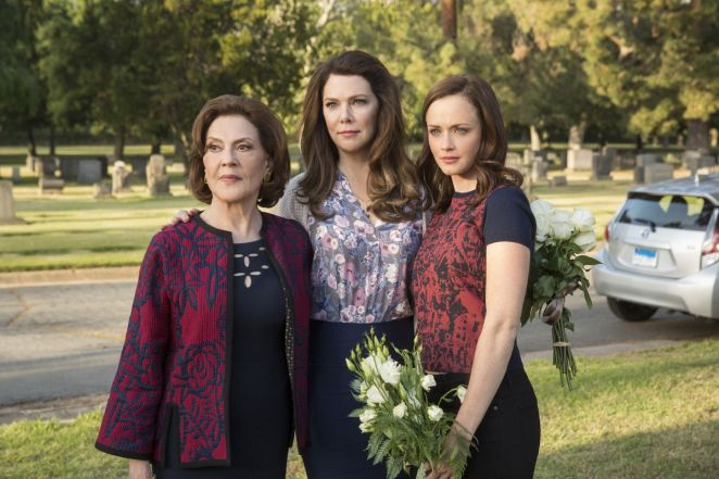 Emily, Lorelai and Rory Gilmore stand at the graveyard