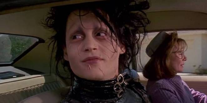 Johnny Depp as Edward Scissorhands smiling, in a car with Dianne Wiest driving
