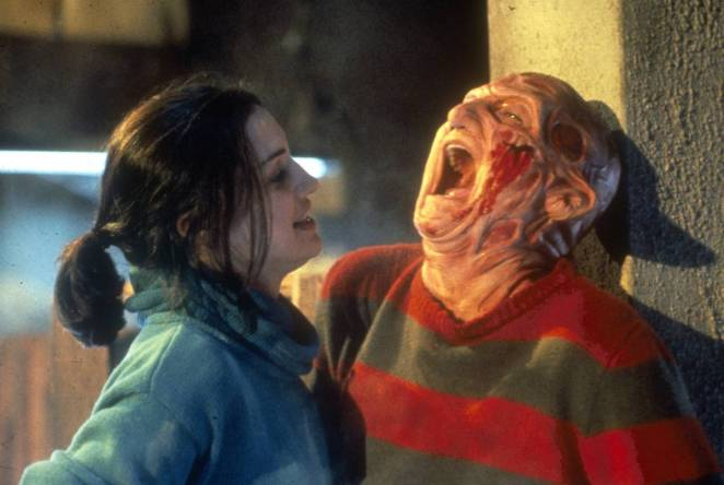 Maggie (Lisa Zane) pins Freddy Krueger (Robert Englund) to the wall with his infamous glove in a final scene of Freddy's Dead
