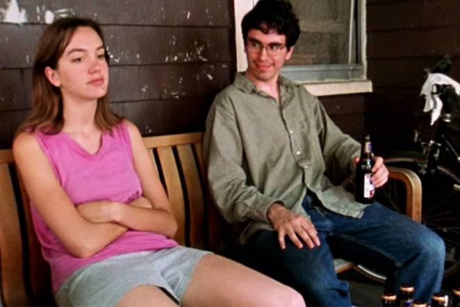 Marnie sits on the porch of her apartment with her former co-worker Mitchell in Funny Ha Ha.