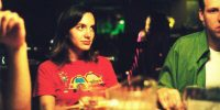 Young adult Marnie eats dinner at a restaurant with friends in Andrew Bujalski's film Funny Ha Ha.