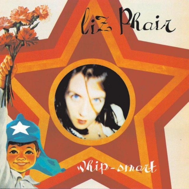 the cover for the Liz Phair album whip smart has an out-of-focus portrait in a circle in the center of a brown red and yellow star. On the left is a painting of a boy in a blue starred hat holding roses into the air.