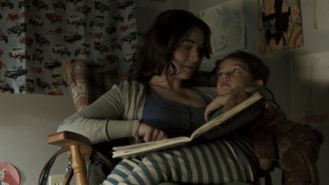 Sarah Bolger and Thomas Bair enjoy a bedtime story in Emilie (2015)
