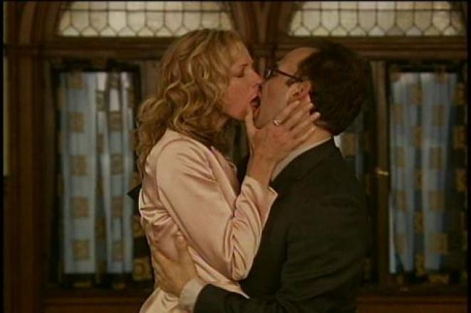 A man and woman make out passionately.