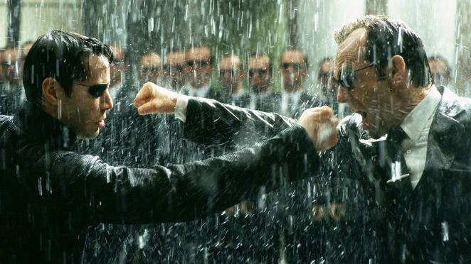 Neo and Agent Smith exchange blows in the rain in The Matrix Revolutions