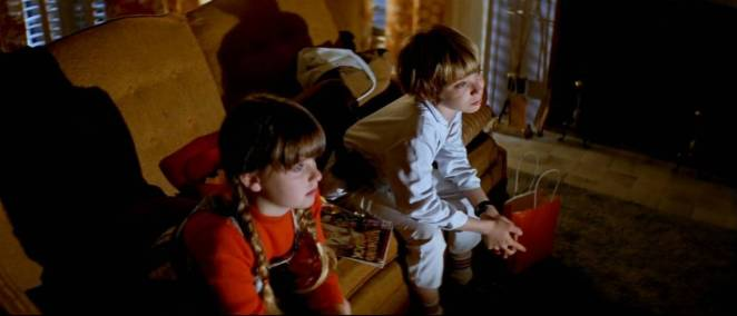 Tommy Doyle & Lindsay Wallace watching scary movies in Halloween