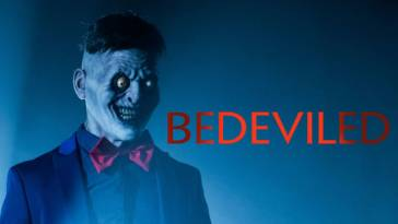 A scary faced man with white old face, yellow eyes popping out of his and red bowtie