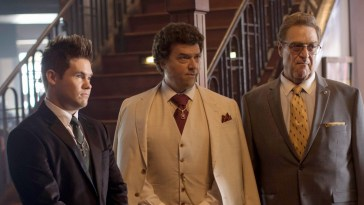 Kelvin (Adam Devine), Jesse (Danny McBride) and Eli (John Godman) confront a rival preacher in a restaurant.