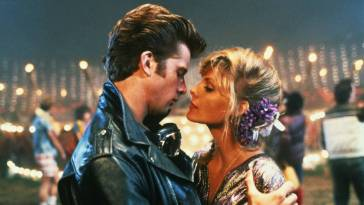 Michael (Maxwell Caulfield) and Stephanie (Michelle Pfeiffer) embrace at the end of Grease 2.