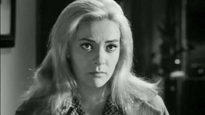 Viridiana (Silvia Pinal) looks pensive.