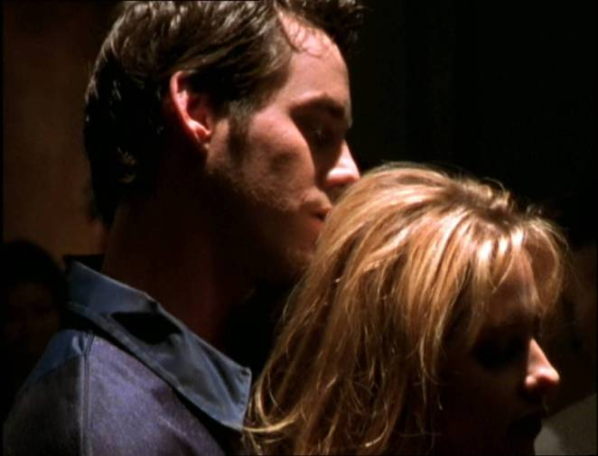 Buffy dances seductively with Xander.
