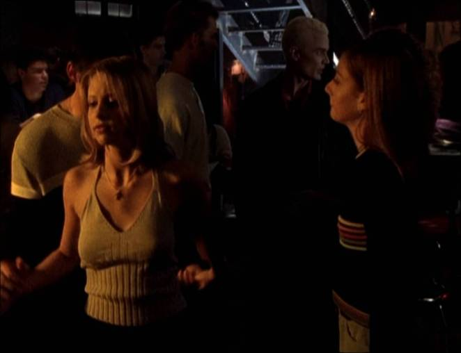 Buffy, Xander and Willow dance at the Bronze while Spike lurks behind them.
