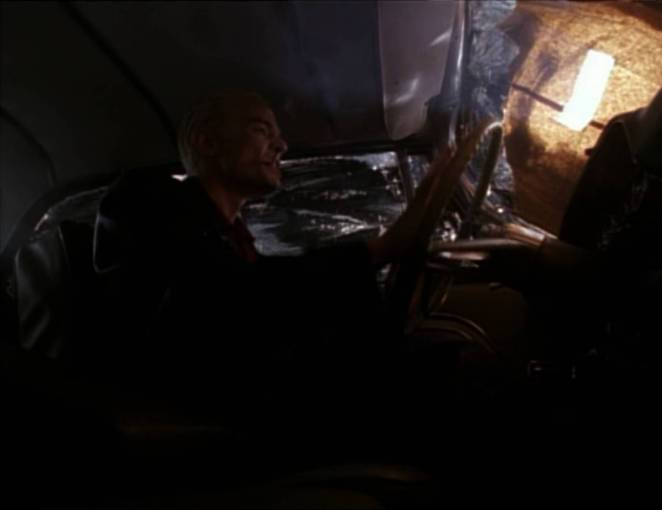 Spike sings while driving his car.
