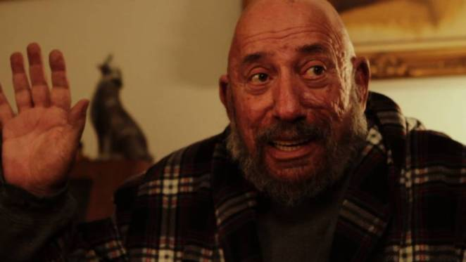 Sid Haig waves looking anxious