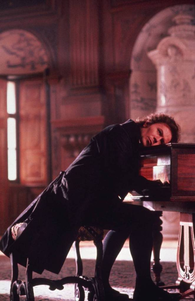 Young Beethoven, alone, presses his ear against the piano as he plays. The vibrations are the only way he can hear his own music.