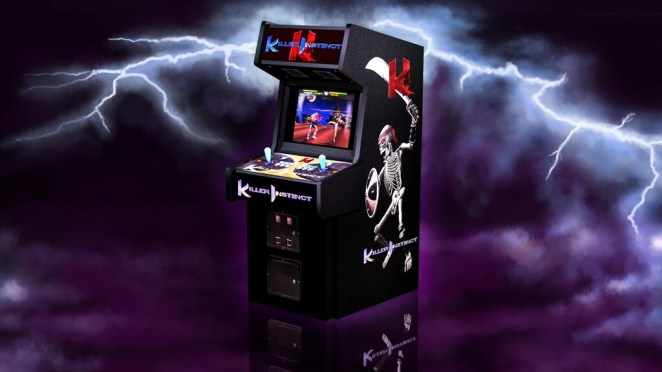 Behind a fake lightning filled skyscape, a Killer Instinct arcade cabinet sits in the middle of the image, on a 45-degree angle so we can see the front where the controller stick, buttons and screen are, and the side, where the artwork is on display.