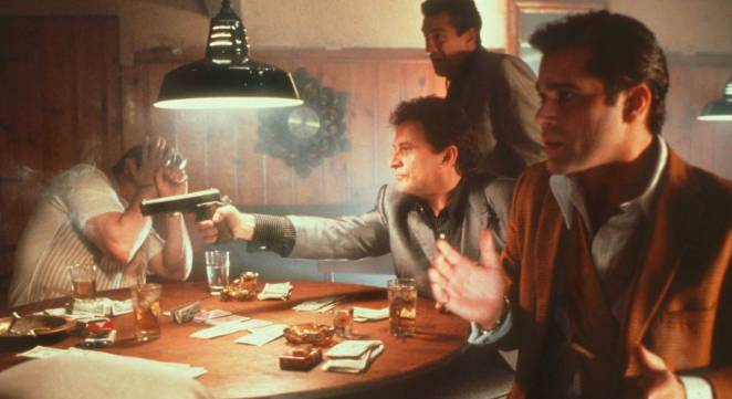 Tommy DeVito shoots Spider in the chest while Jimmy and Henry look on in disbelief