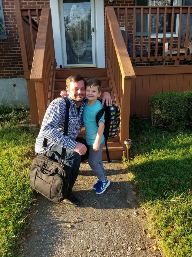 Andrew Grevas posing with his son Jack on Jack's first day of school