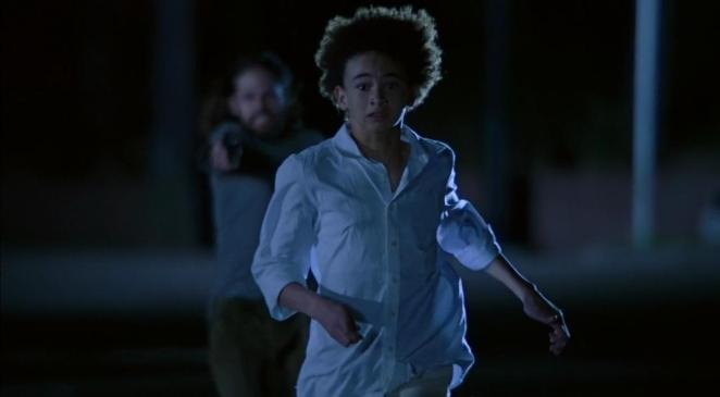 Riley runs from the crazed gunman who killed his family.