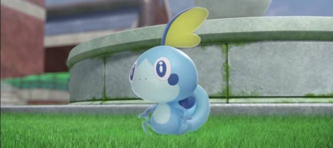 Sobble standing in front of a fountain