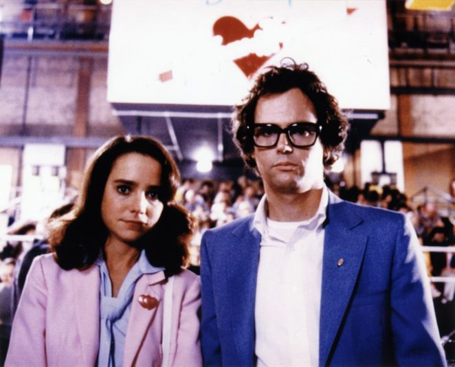 """Janet (Jessica Harper) and Brad Majors (Cliff De Young) stand in from of the Denton Home of Happiness sign in """"Shock Treatment"""""""